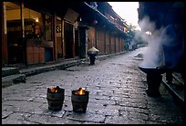 Dumplings being cooked in a cobblestone street. Lijiang, Yunnan, China ( color)