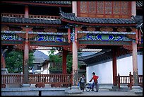 Children in an archway. Lijiang, Yunnan, China ( color)