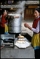 Naxi Woman preparing the baba flatbreat. Lijiang, Yunnan, China ( color)