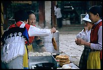 Naxi Women preparing the baba flatbreat. Lijiang, Yunnan, China ( color)