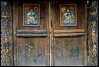 Decorated doors of a temple. Lijiang, Yunnan, China (color)