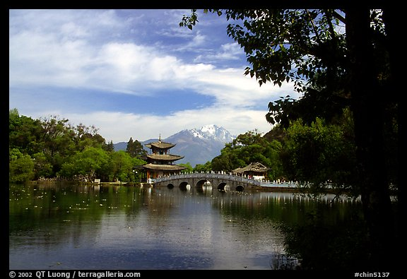Pavillon reflected in the Black Dragon Pool, with Jade Dragon Snow Mountains in the background. Lijiang, Yunnan, China (color)