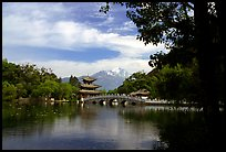 Pavillon reflected in the Black Dragon Pool, with Jade Dragon Snow Mountains in the background. Lijiang, Yunnan, China