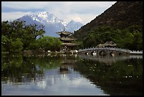 Pavillon and Jade Dragon Snow Mountains reflected in the Black Dragon Pool. Lijiang, Yunnan, China