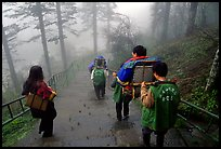 Weathy pilgrim carried on a chair. Emei Shan, Sichuan, China ( color)
