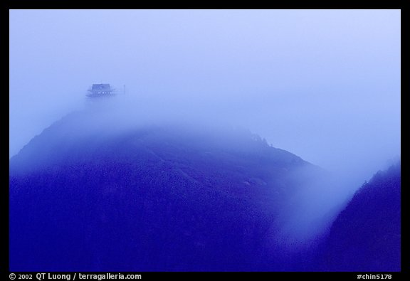 Fog sweaps over Wanfo Ding (Ten Thousand Buddhas Summit) at dusk. Emei Shan, Sichuan, China (color)