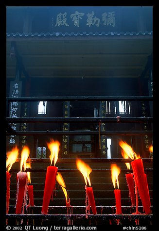 Candles burning in front of Wannian Si temple. Emei Shan, Sichuan, China (color)