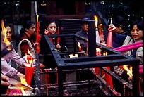 Pilgrims burning big incense batons. Emei Shan, Sichuan, China (color)