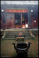Urn in courtyard inside Xixiangchi temple. Emei Shan, Sichuan, China