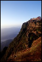 Sunrise on Jinding Si (Golden Summit), perched on a steep cliff. Emei Shan, Sichuan, China (color)