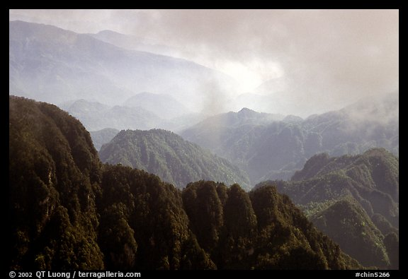 Forest-covered slopes and ridges of Emei Shan. Emei Shan, Sichuan, China (color)