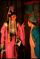Two characters of Sichua opera on stage. Chengdu, Sichuan, China (color)