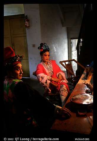 Sichuan opera actors getting ready in the backstage before the performance. Chengdu, Sichuan, China