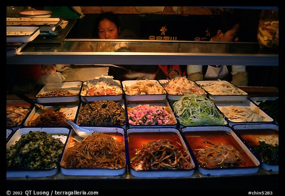 Food stall by night. Sichuan food is among China's spiciest. Chengdu, Sichuan, China (color)
