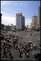 Pedestrians and bicyclists cross a major avenue. Chengdu, Sichuan, China ( color)