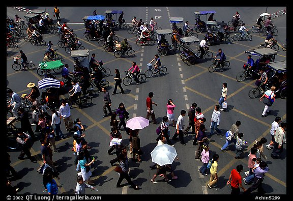 Pedestrians and bicyclists cross a major avenue. Chengdu, Sichuan, China (color)