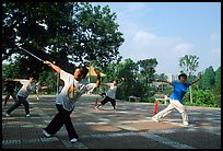 Collective exercise gymnastics with swords,  Liuha Park. Guangzhou, Guangdong, China ( color)