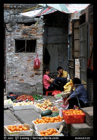Fruit vendors in a narrow alley. Guangzhou, Guangdong, China (color)