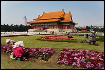 Grounds of Chiang Kai-shek memorial with workers and tourists. Taipei, Taiwan (color)