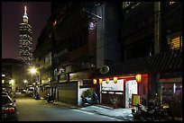 Dark street, store with lanters, and Taipei 101. Taipei, Taiwan (color)