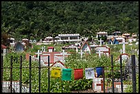 Prayer flags and graves on hillside, Chongde. Taiwan (color)