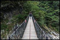 Hiker on suspension footbridge, Taroko Gorge. Taroko National Park, Taiwan (color)