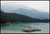 Houseboats and misty mountains. Sun Moon Lake, Taiwan (color)