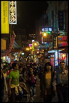 People on main street at night, Shueishe Village. Sun Moon Lake, Taiwan (color)