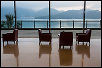 Chairs in hotel lobby with view of lake. Sun Moon Lake, Taiwan (color)