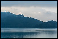 Shabalan Mountain ridge in mist with Syuanzang Temple and Tsen Pagoda. Sun Moon Lake, Taiwan (color)