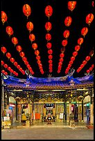 Array of red paper lanterns and temple at night. Lukang, Taiwan (color)
