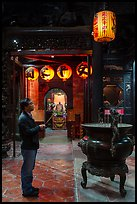 Man praying to Matsu, Tienhou Temple. Lukang, Taiwan (color)