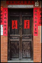 Wooden door with chinese writing on red paper. Lukang, Taiwan (color)