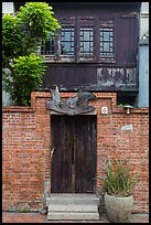 Brick wall and historic wooden house. Lukang, Taiwan (color)