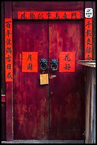 Wooden door traditional lock and chinese inscription on red paper. Lukang, Taiwan (color)