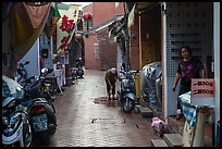 Woman cleaning in alley. Lukang, Taiwan (color)