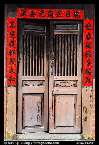 Wooden door with chinese script on red paper. Lukang, Taiwan (color)