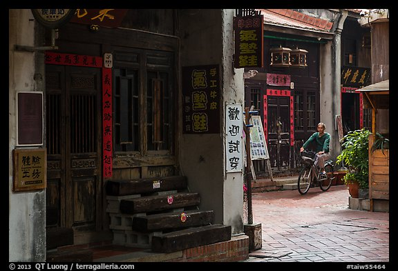 Man on bicycle amidst old houses in alley. Lukang, Taiwan (color)