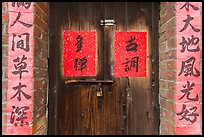 Wooden door and brick wall with Chinese writing. Lukang, Taiwan ( color)