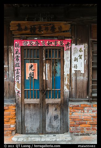Door with weathered wood and inscriptions. Lukang, Taiwan (color)