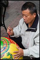 Man painting paper lantern. Lukang, Taiwan ( color)