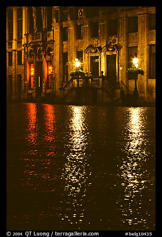Lights reflected in wet cobblestones, Grand Place. Brussels, Belgium