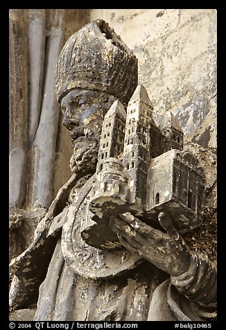 Statue outside of Notre Dame Cathedral showing a model of the cathedral being held. Tournai, Belgium (color)