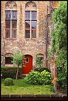 Brick house with small garden by the canal. Bruges, Belgium