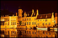 Houses reflected in canal, Rozenhoedkaai, night. Bruges, Belgium ( color)