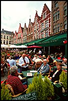 People in restaurants on the Markt. Bruges, Belgium ( color)