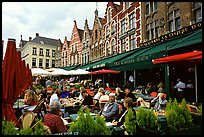 People in restaurants on the Markt. Bruges, Belgium (color)