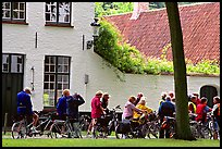 Bicylists in Courtyard of the Begijnhof. Bruges, Belgium