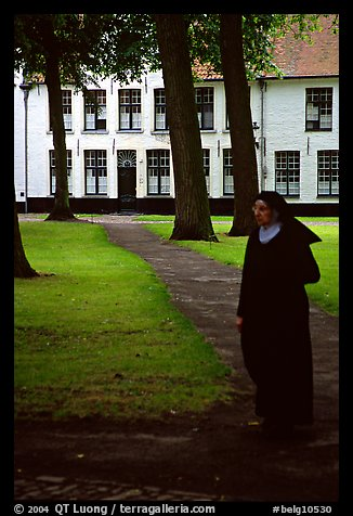 Benedictine nun in the Begijnhof. Bruges, Belgium