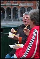 Elderly women eating fries. Bruges, Belgium